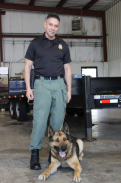 Canine Handler/Trainer, Jamey Jordan, with his tracking dog